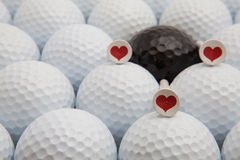 Different golf balls and romantic tees Royalty Free Stock Images