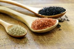 Different gourmet varieties of salt - black and red Hawaiian Stock Photography