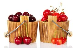 Different grades of sweet cherries in wooden Royalty Free Stock Photo
