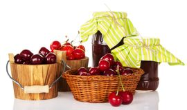 Different grades of sweet cherry in buckets Stock Photos