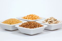 Different grain in white bowls Stock Photos