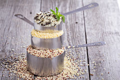 Different grains in  measuring cups Stock Photos