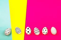 Different graphic hand drawn eggs on bright background in trendy colors. royalty free stock photos
