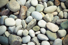 Different gray stones pebble beach. Toned Stock Image
