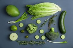 Different green vegetables and fruits on dark background. Top view royalty free stock image