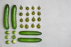 Different green vegetables on grey background stock image