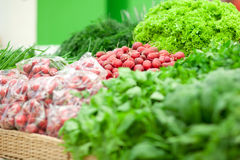 Different green vegetables on the supermarket shelf. Close up Stock Photos