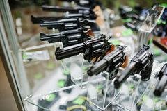 Different guns and revolvers on shelves store weapons on shop ce stock images