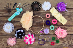 Different hair clips on wooden background Royalty Free Stock Image