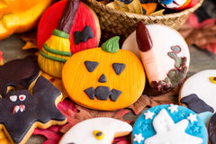 Different halloween cookies on table with autumnal leaves Stock Images