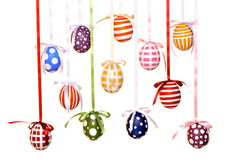 Different hand-painted Easter eggs with bows Stock Image