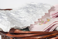 Different hand towels into a wicker basket, on white background Stock Images
