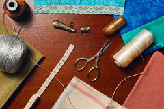 Different handicraft accessories and materials. Home dressmaker concept, tailor hobby still life - top view Royalty Free Stock Photos