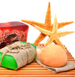 Different handmade soaps, starfishes and bath bombs Royalty Free Stock Photos