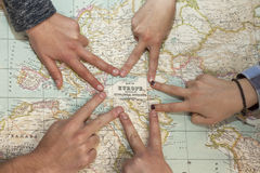 Different hands drawing a star pointing Europe in a world map Stock Photos