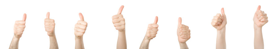 Different hands with thumbs up. Isolated on white stock photography