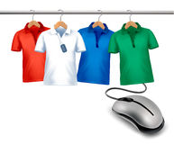 Different hangers with shirts and a computer mouse. Stock Images