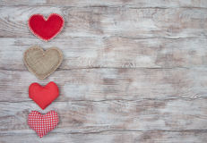 Different hearts on wooden rustic table. Love and Valentines Day Stock Image