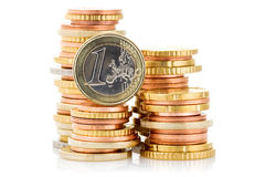 Different height stacks of Euro coins. On white background Royalty Free Stock Image