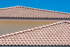 Mediterranean-roofed roofs of a stylish residential building royalty free stock photo