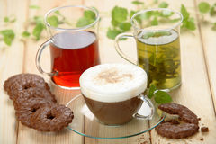 Different hot drinks. On the wooden table royalty free stock image