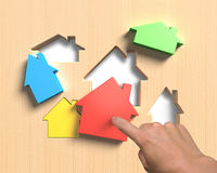 Different houses suit house shape holes board with hand assembli Royalty Free Stock Photo
