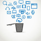 Different icons flowing into a garbage basket Stock Photography