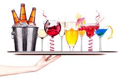 Different images of alcohol on a waitress tray Royalty Free Stock Image