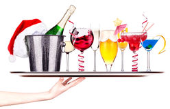 Different images of alcohol on a waitress tray royalty free stock photo