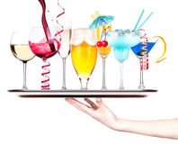 Different images of alcohol on a waitress tray Royalty Free Stock Images