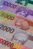 Different Indonesian rupiah on the table Stock Photos