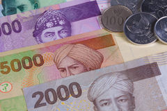 Different Indonesian rupiah on the table Royalty Free Stock Images