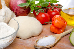 Different ingredients to make a pizza Stock Images