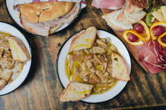 Different Italian dishes. From the sleep of a wooden table shot from above Stock Photography