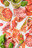Different Italian sausage,ham and bruschettas Royalty Free Stock Photography