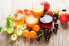 Different juices and fruits Stock Image