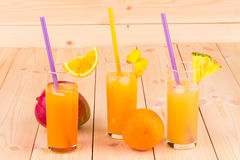 Different juices with fruits in the closeup. Royalty Free Stock Photos