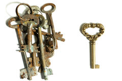 Different keys pile of rusty old and one new shiny on white back Stock Image