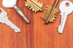 Different keys on wooden table Stock Image
