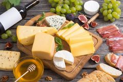 Different kind of cheese. With wine, figs, walnuts, jamon Stock Photography