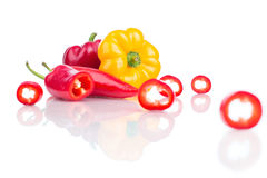 Different kind of fresh peppers  on white. Close up Royalty Free Stock Photography