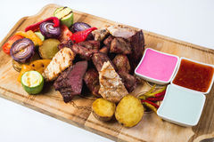 Different kind of grilled meat with sauces on Royalty Free Stock Photo