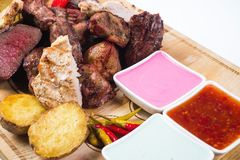 Different kind of grilled meat with sauces on Stock Photo