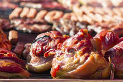 Different kind on grilled meat, sausages and fried potatoes with smoke and steam Stock Photos