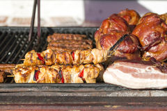 Different kind on grilled meat and sausages with smoke and steam Stock Photo