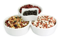 Different Kind of Legume. Mixed colorful beans in a white bowl stock images