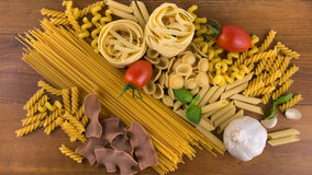 Different kind of raw pasta Stock Photos