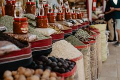 Spices on an asian market. Different kind of spices in big baskets. So many unique types, tastes and aromas Stock Photos