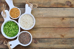 Different kinds of bean seeds on a wooden table Royalty Free Stock Images
