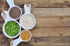Different kinds of bean seeds on a wooden table Stock Images